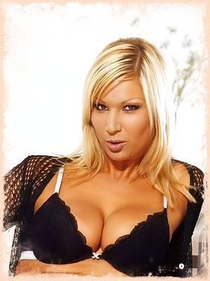 Busty blonde shows her huge hangers