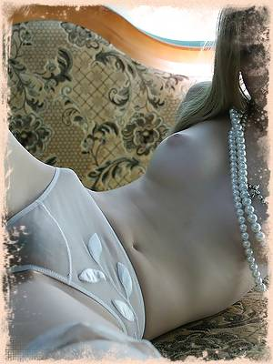 Nadja posing in nothing but sheer panties and perl collar