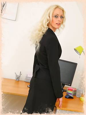 Sexy secretary Shelley strips out of her smart office outfit.