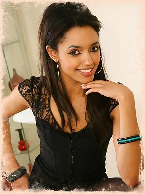 Stunner Natasha looking hot wearing a green miniskirt and tight black top.