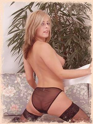 Dana looks so horny with her black stockings on