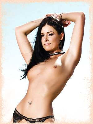 India Summer wrapped in a fishnet top and stockings
