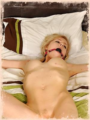 Blonde bitch tied up and forgotten in bed