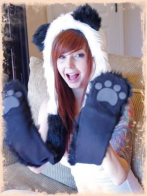 Ivy Snow plays around with her panda outfit and high socks