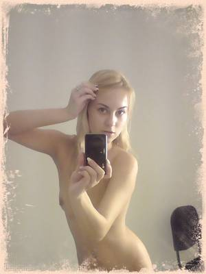 Blonde teen shows off some great nude mirror poses